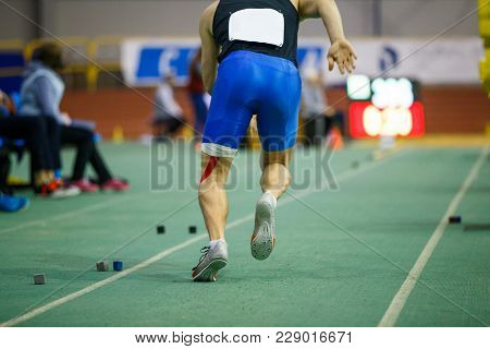 Sportsman Starting Acceleration In Long Jump Competition. Track And Field Competitions Concept Backg
