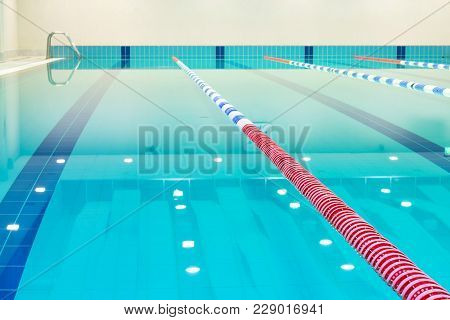 Lap Pool With Marked Lanes. Empty Swimming Pool Without People With Quiet Standing Water. Water Spor