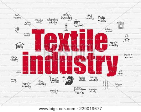 Manufacuring Concept: Painted Red Text Textile Industry On White Brick Wall Background With  Hand Dr
