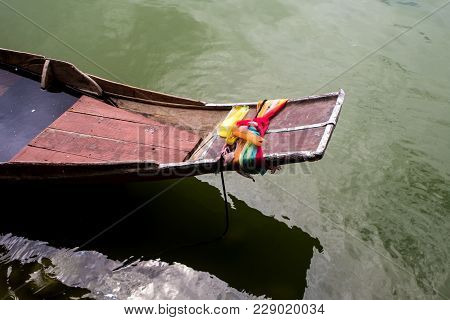 Colorful Satin Tie At The Prow Of Boat Is Worship