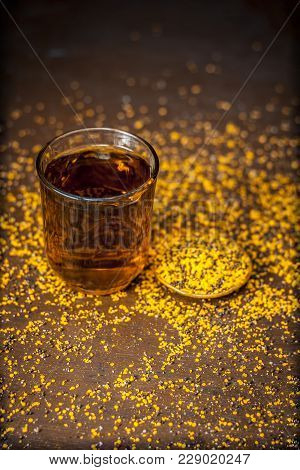 Close Up Of  Extracted Water Of Lal Sarson/brown Mustard  Seeds In A Transparent Glass With Crushed