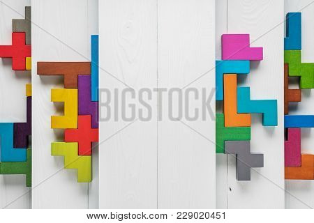 Multilevel White Wooden Background With Multi-colored Geometric Shapes.  Different Colorful Shapes W