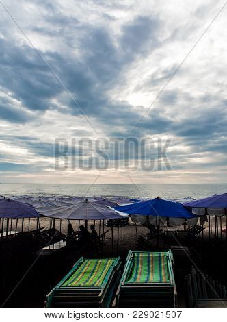 Colorful Canvas Daybed Under The Beach Umbrella