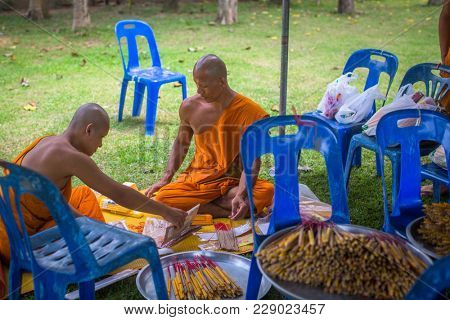 KOH CHANG, THAILAND - MAR 1, 2018: Monks during celebration of Makha Bucha Day. One of the three most important holidays of Buddhism, which dictates its social norms to locals and foreign tourists.