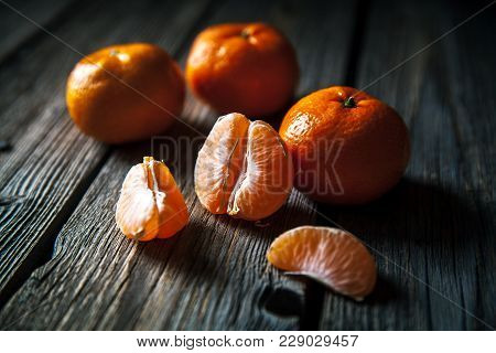 Tangerines On A Wooden Background. Fresh Fruit. Healthy Food A