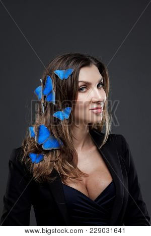 Beauty Fashion Model Girl Surrounded By Swarms Of Butterflies.