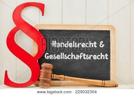 German words Handelsrecht & Gesellschaftsrecht (commercial law & corporate law) as concept on a blackboard