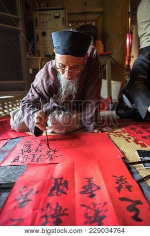 Hanoi, Vietnam - Jun 22, 2017: Scholar Writes Chinese Calligraphy Characters In Communal House At So