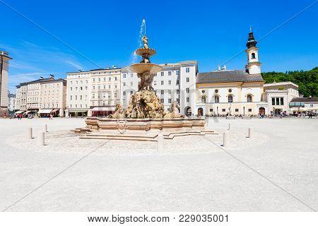 Residenzbrunnen Fountain On The Residenzplatz Square In Salzburg, Austria. Residenzplatz Is One Of T