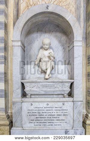 Rome, Italy - June 17, 2014: Marble Sculpture Of The Baby In Basilica Dei Santi Ambrogio E Carlo Al