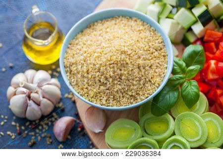 bowl of bulgur with fresh vegetables ready to cook - food and drink
