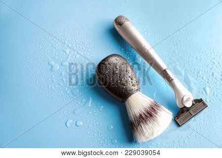 Shaving brush and razor for man on color background