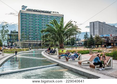 Katowice, Poland - July 3, 2016: People Rests On A Renovated Part Of Defenders Square In Katowice Ci