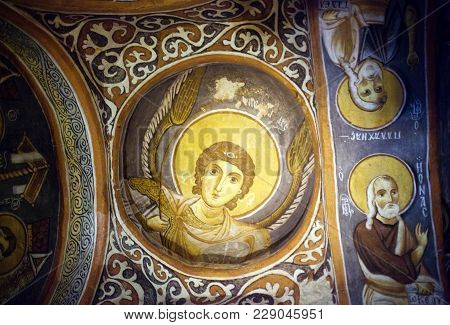 Goreme, Turkey - May 16, 2016: Ancient Mural Painting With Archangel Michael In Dark Cave Church In