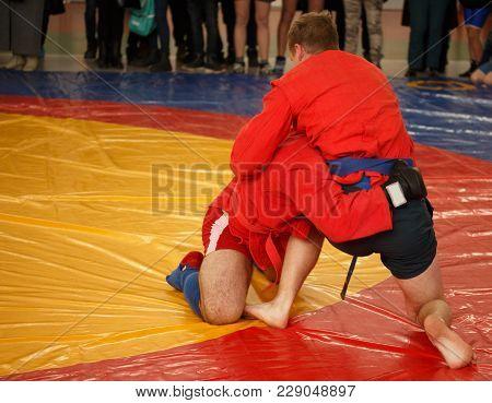 Sumbo, Judo, Jiu Jitsu, Maa. Two Men Are Fighting On Wrestling Mat
