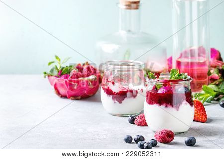 Jars Of Natural White Yogurt With Berry Sauce, Fruit Salad With Pink Dragon Fruit, Berries And Mint,