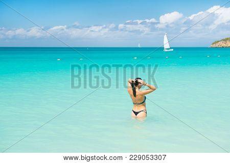 Woman In Sexy Bikini On Sea Beach In Antigua. Sensual Girl In Blue Sea Or Ocean Water On Sunny Day.