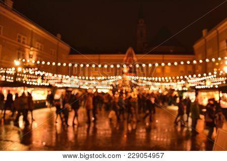 Illumination Of Christmas Market In Salzburg, Austria. Christmas Bokeh Lights