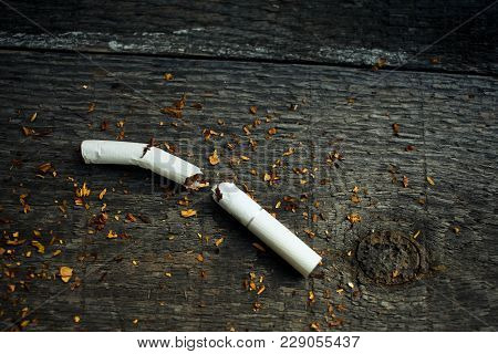 No For Smoking, Yes For Health. The Broken Cigarettes On A Wooden Background