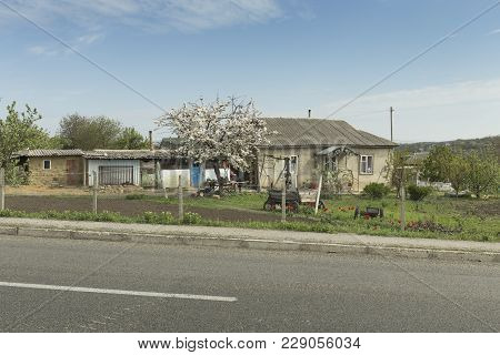 Small Rural House. It Located Near A Main Road.
