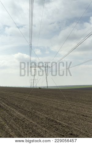 Lanscape With Power Line. High Voltage Electric Transmission Tower Energy Pylon.
