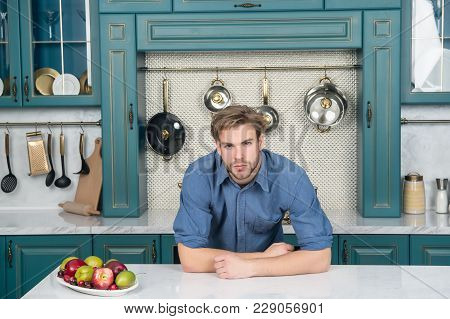 Guy With Fresh Fruit Plate On Table, Vitamin. Macho With Beard In Blue Shirt In Kitchen, Cuisine. He