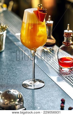 Rosemary Cocktail - Golden Rum, Rosemary, Fruits Juice And Syrup On A Gray Bar Counter. Still Life