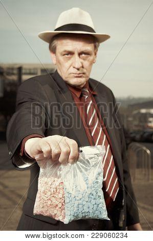 Older Dealer Of Narcotics Selling Drugs On Day Time On Street