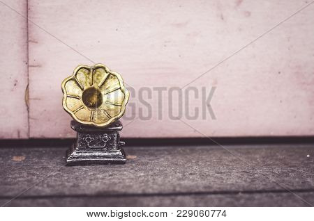 Vintage Miniature Gramophone Over Wooden Wall. Copy Space On The Right For Text