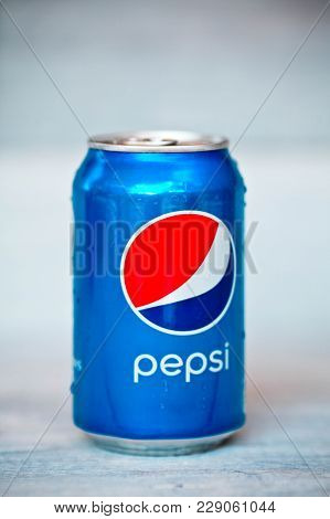 Krasnodar, Russia - On August 14, 2016 : Pepsi Can On White Wood. Pepsi Is A Carbonated Soft Drink P