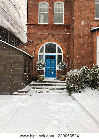 HAMPSTEAD, LONDON - FEBRUARY 28, 2018: Residential house exterior on a snowy day in a suburban street of Hampstead, North London, UK.