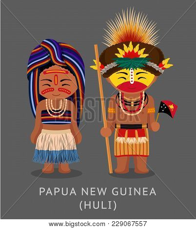 Papua New Guinea. Huli Tribe. People In National Dress With A Flag. Man And Woman In Traditional Cos