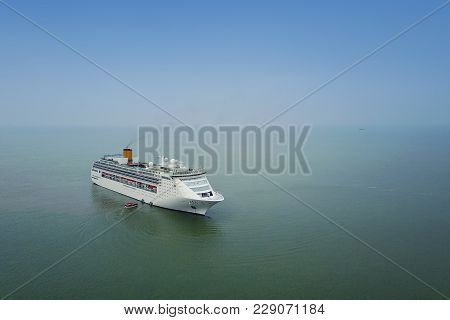 White Luxury Cruise Ship Docked In Beautiful Caribbean Sea Close To The Beach.