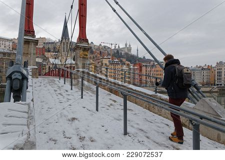 Lyon, France, March 1, 2018 : Pedestrian Bridge Over Saone River, As A Cold Spell Rages In All Europ
