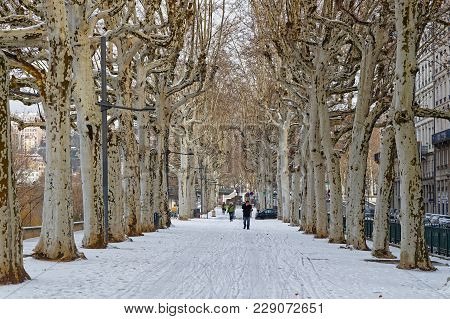 Lyon, France, March 1, 2018 : Pedestrian Walkways On Rhone River Banks, As A Cold Spell Rages In All