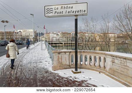 Lyon, France, March 1, 2018 : Trafic On A Bridge Over Rhone River, As A Cold Spell Rages In All Euro