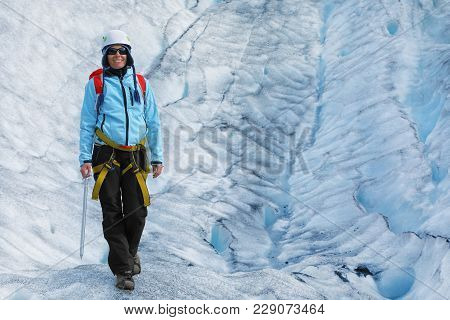 Young Woman Climber Standing In The Cleft Of The Falljokull Glacier (falling Glacier), Iceland