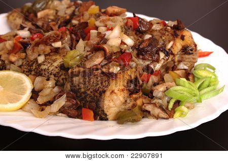baked fish with vegetables on white plate poster