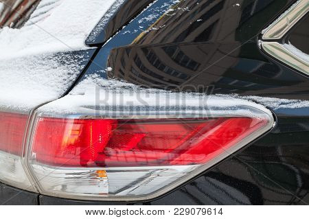 Rear Stop Lights Of Suv Car Covered With Snow, Winter Season