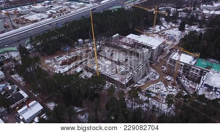Aerial View Of A Large Construction Site. A Residential High-rise Building And A Construction Crane.