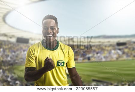 Afro young Brazilian man fan celebrating
