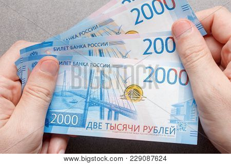 New Russian Banknotes Denominated In 2000 Rubles In Male Hands Close-up, Top View