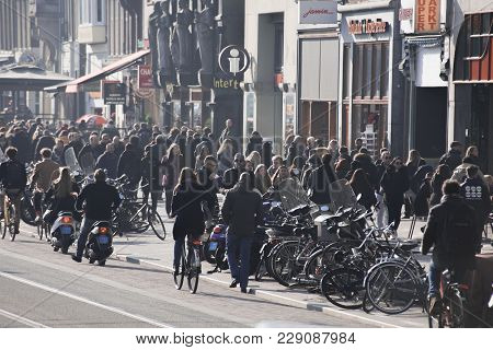 Amsterdam / The Netherlands - February 14th Busy Damrak Street In The Capital City Amsterdam, People