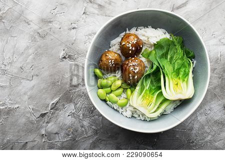 Healthy Home Cooking. Meat Balls Teriyaki, Rice, Cabbage Bok Choy Bowl With Sesame Seeds In A Cerami
