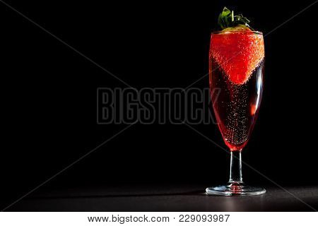 Celebration Drink. Glass Of Sparkling Pink Champagne Wine With Strawberry. Perfect Valentines Or Ann