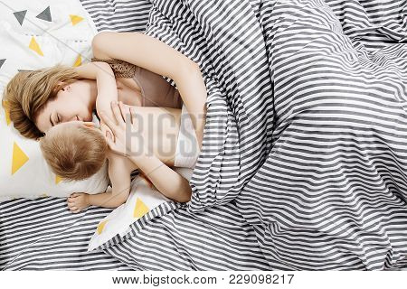 Mom With A Little Son Wake Up In The Morning. Morning Waking Mother And Baby. Embrace.