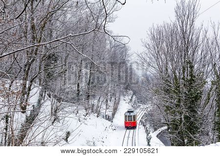 The Historical Sassi - Superga ( Turin-italy) Rack Tramway In Winter Time.the Rack Tramway Is Drawn