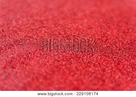 Red Glitter Defocused Texture Background. Red Christmas Abstract Background