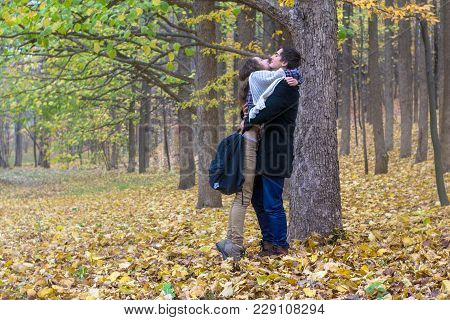 Lovers Met In The Woods After Classes. Happy Students Firmly Hugged.