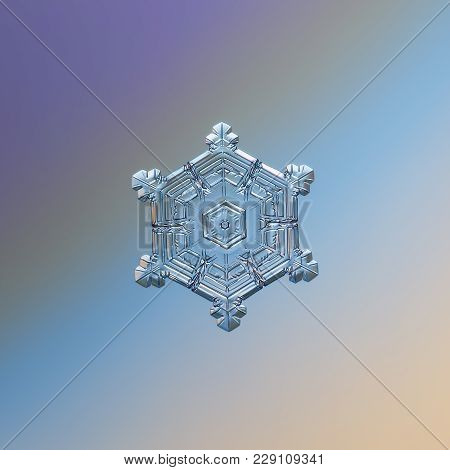 Snowflake Glittering On Light Gradient Background. Macro Photo Of Real Snow Crystal: Sectored Plate